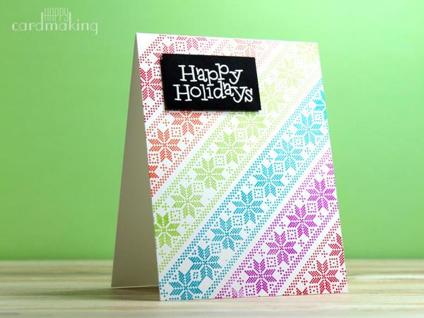 Tarjeta navideña realizada con estampación de diferentes colores vivos