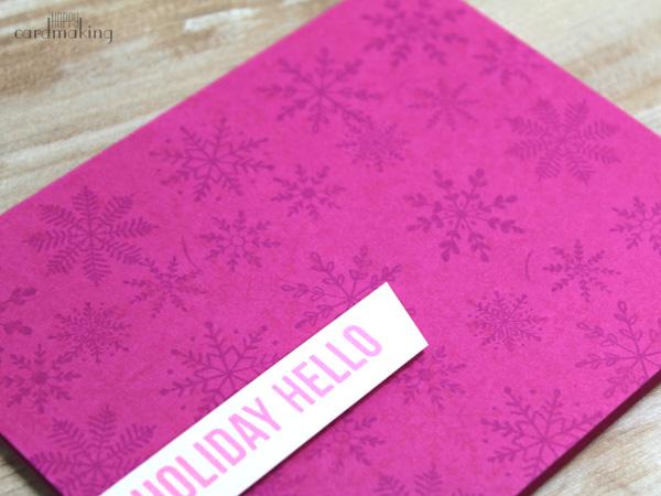 Tarjeta navideña fácil realizada con los sellos de copos de nieve de Tiger