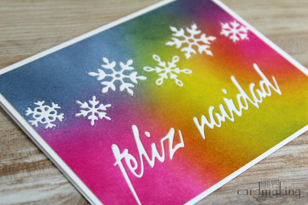 Tarjetas navideñas creadas con fondo de tintas distress y troqueles